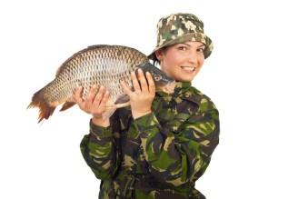 Angler woman showing big carp