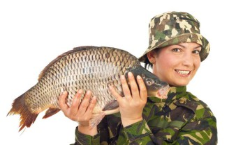 Angler woman showing a big carp isolated on white background